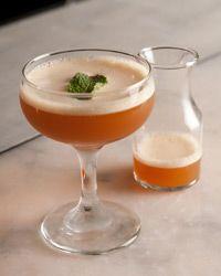 New twist on a Pimm's Cup using elderflower liqueur and muddled mint