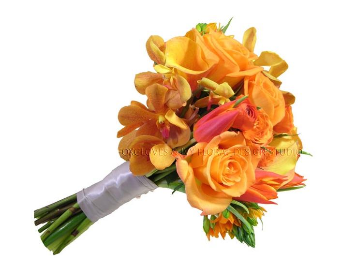 Bridesmaid bouquet.. Mokara orchids, Dutch tulips, Dubium, yellow mini callas, 'Voodoo' roses, spray roses and ranunculus.