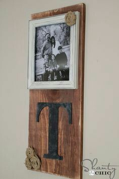 Wooden board with picture frame and family name initial glued on. #wallart