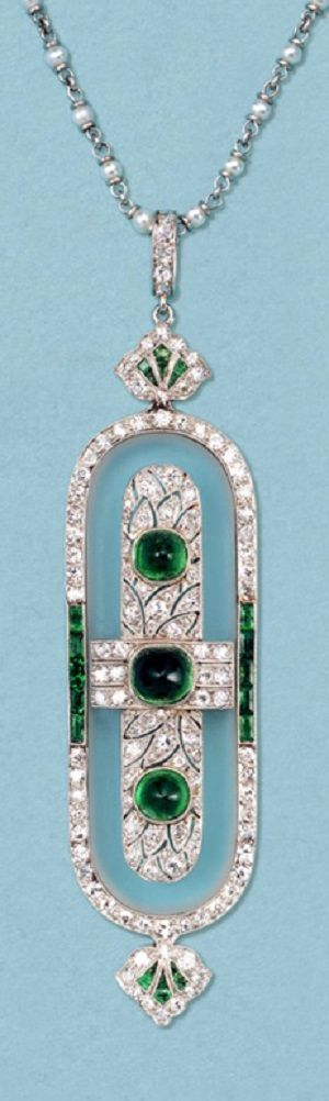 An Art Deco platinum, rock crystal, diamond and Columbian emerald brooch/pendant, circa 1925.