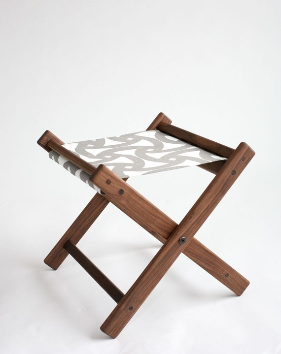 Camping stool with geometric printed fabric