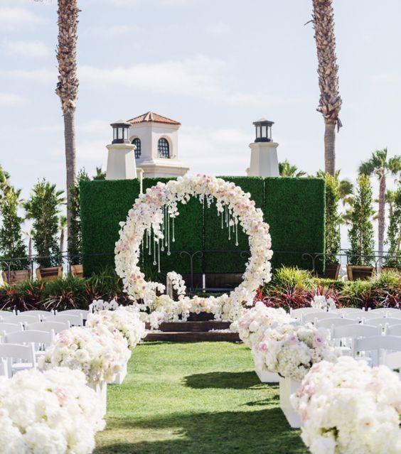 Stunning outdoor white flower wedding ceremony; Featured Event Design: Blush Botanicals