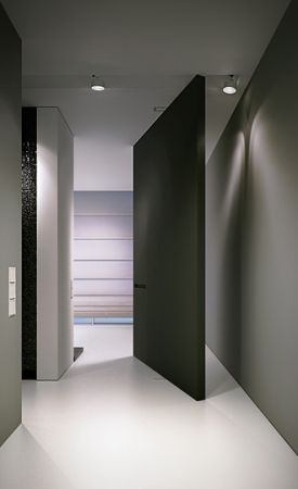 Extra large pivot door and elegant hallway, project in Gdynia by arch515 _