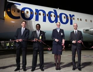 """Mit einem symbolischen Ribbon Cutting am Gate feierte Condor am gestrigen Abend den ersten Flug von Wien nach Mombasa.""  - See more at: http://www.tip-online.at/news/28101/condor-hebt-nach-kenia-ab/?utm_source=newsletter&utm_medium=email&utm_campaign=tip-daily_06.11.2013"
