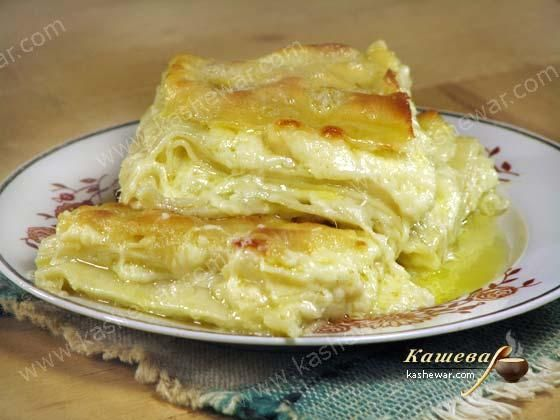 Ачма.        Грузинская кухня       Ачма – рецепт приготовления блюда грузинской кухни, ачма очень вкусная и сытная, готовится из сыра сулугуни.  Ингредиенты ачмы  Мука пшеничная – 1 кг Сыр сулугуни …