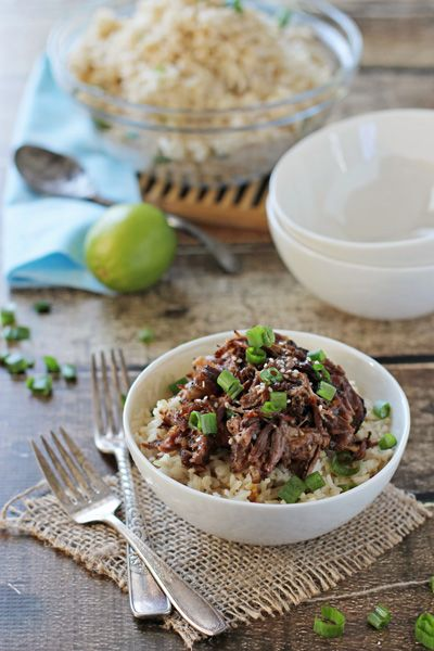 Recipe for crockpot asian short ribs. Tender, fall off the bone beef short ribs with soy sauce, ginger and garlic. Serve with coconut rice and bok choy.