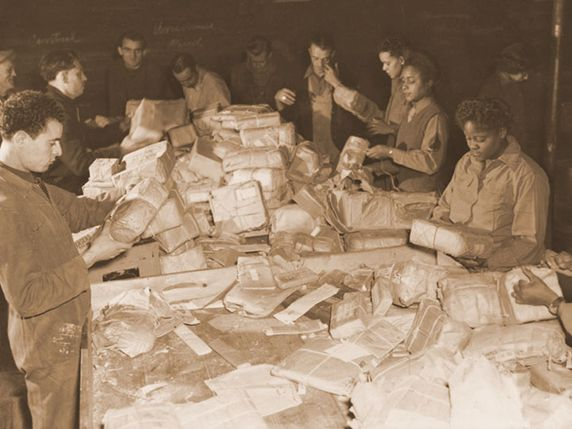 French civilians and Soldiers from the 6888th Central Postal Directory Battalion sort mail in the spring of 1945. The only African-American Women's Army Corps unit sent to Europe during World War II, the 6888th was responsible for clearing years' worth of backlogged mail in both England and France. Viewing their jobs as crucial to morale at the front, they processed some 65,000 pieces of mail a shift and worked three shifts a day. At the same time, the Soldiers faced constant prejudice and…
