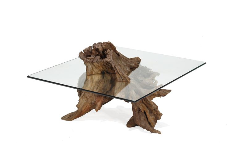 Root Coffee Table is the ultimate representation of how nature prevails! The entire basis of the table is the root on which it stands on. THIS ITEM SHIPS FOR FREE! STORY The glass table top has been c
