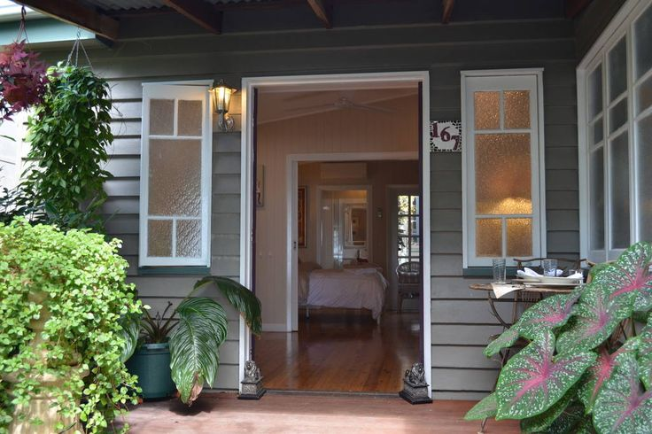 Front door of B&B unit with private porch to sit & watch the waves