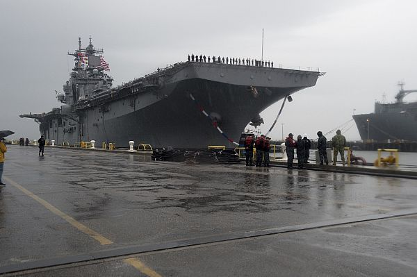 The amphibious assault ship USS Wasp (LHD 1) arrives at Naval Station Norfolk as part of the Wasp Amphibious Ready Group (WSP ARG) following a six-month deployment in support of maritime security operations and theater security cooperation efforts in Europe and Middle East. WSP ARG includes Commander, Amphibious Squadron 6; USS Wasp (LHD 1); USS San Antonio (LPD 17); USS Whidbey Island (LSD 41) and 22nd Marine Expeditionary Unity (MEU).  U.S. Navy photo by Mass Communication Specialist 1st…