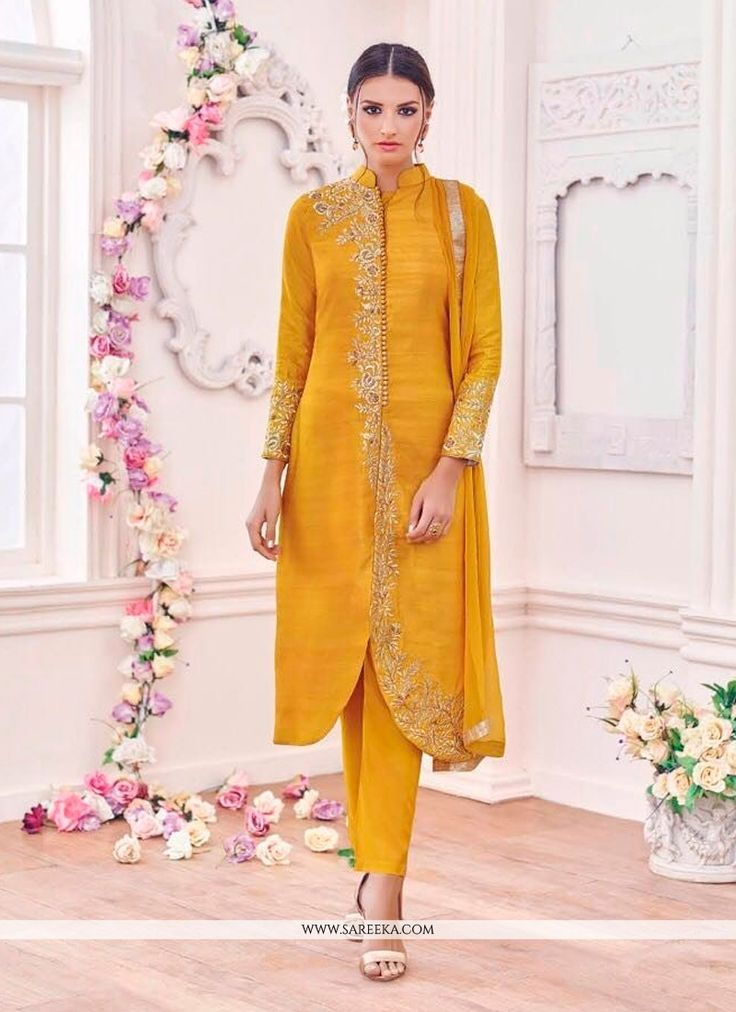 An remarkable mustard banglori silk designer suit will make you appear highly stylish and graceful. The embroidered and resham work looks chic and ideal for any affair. Comes with matching bottom and ...