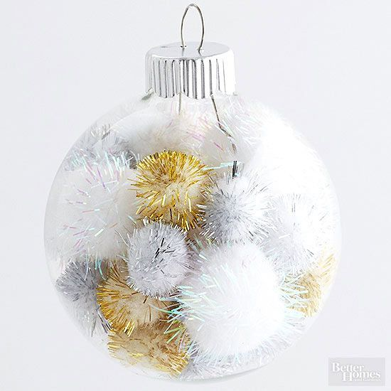 Insert gold, silver, and whitepom-poms in a clear glass ballornament for a sparkly, energetic look for your tree./