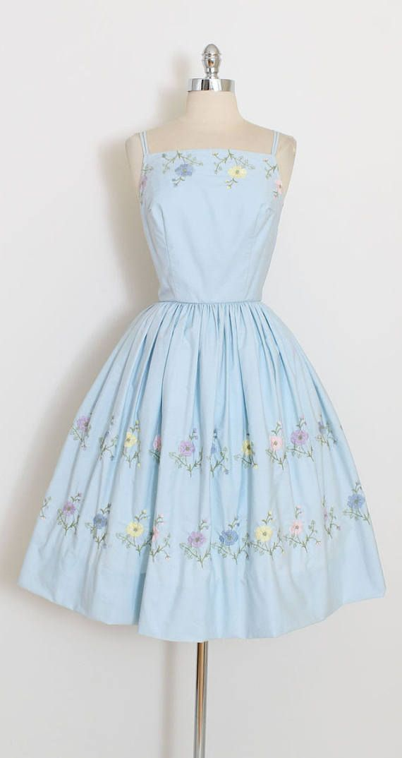 ➳ vintage 1950s dress * beautiful sky blue cotton dress * colorful embroidery * polished cotton * tulle skirt lining * metal back zipper * full skirt * by LAiglon condition | excellent fits like xs/s length 41 bodice 16 bust 36 waist 26 ➳ shop http://www.etsy.com/shop/millstreetvintage?ref=si_shop ➳ shop policies http://www.etsy.com/shop/millstreetvintage/policy twitter | MillStVintage facebook | millstreetvintage instagram | millstr...