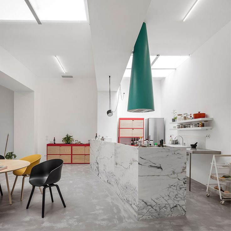 from a windowless garage to a functional micro-home, fala atelier has converted this modestly sized hangar in lisbon into a cosy and characterful house.