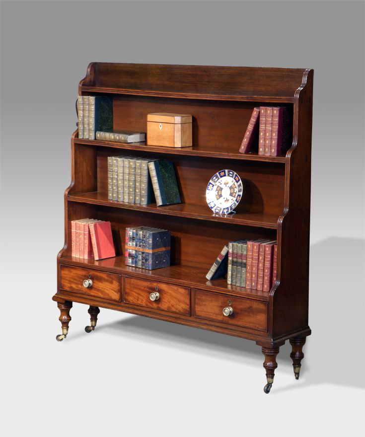 Regency mahogany waterfall bookcase. Three moulded shelves over three beaded drawers fitted with brass knobs. Raised on turned feet capped with brass castors. circa. 1825 £2,650 http://www.thakehamfurniture.co.uk/recent-acquisitions/now-in/antique-waterfall-bookcase-20-58-refno-2687/