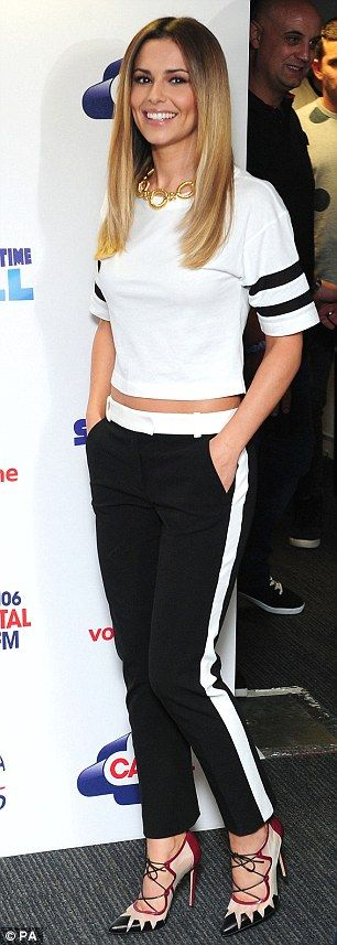 Monochrome: As she arrived Cheryl wore a pair of black trousers and a white top...
