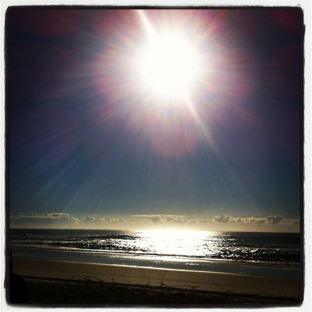 The morning sun over Surfers beach Qld