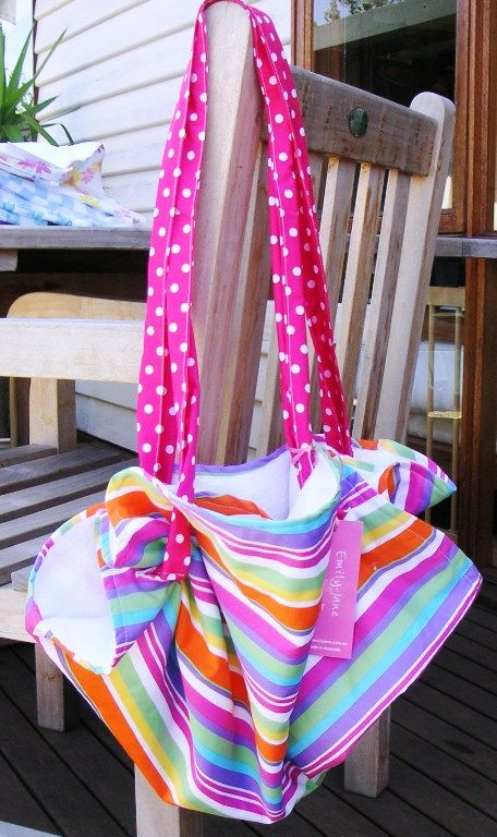 3 in One Bag-For mums and bubs on the go.  Lay bag out into a large flat circle with towelling on one side and brightly coloured prints on the outer.  Change baby's nappy at the park or the beach, Use also to dry baby with the towelling side after a swim.   When finished; and just place nappy change items or babys special things in the middle, grab the straps and pull bag into a shoulder bag.....   Hang it on the back of the door at home to tidy away toys...So Many Uses!  Get yours at EJ…
