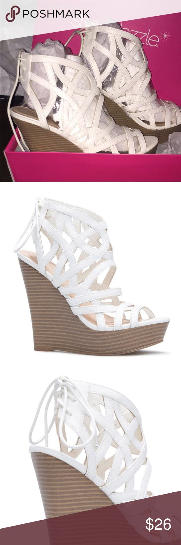 NWT SHOEDAZZLE WEDGES Super cute! I bought them for a wedding and they are just too high of a heel for me! Never worn only tried on, lace up in the back, stickers still on the bottom. I payed $60 because I didn't want the VIP MEMBERSHIP, will come with box and all the packaging shown! Only 2 left in stock online! MAKE AN OFFER!!! Shoe Dazzle Shoes Wedges