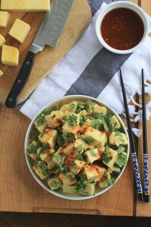 Burmese Tofu Salad - * half of a batch of chickpea tofu (about one pound), cut into small cubes * 3 Tablespoons toasted sesame seeds * 1 cup chopped fresh cilantro leaves * 1 clove garlic, minced * 1 Tablespoon fish sauce * 3 Tablespoons rice vinegar * 1 Tablespoons shallot oil  * 1 teaspoon salt