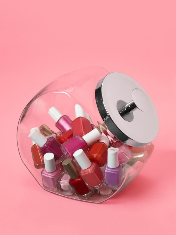 Nail polish taking over the bathroom? stash them in an old-fashioned glass candy jar.