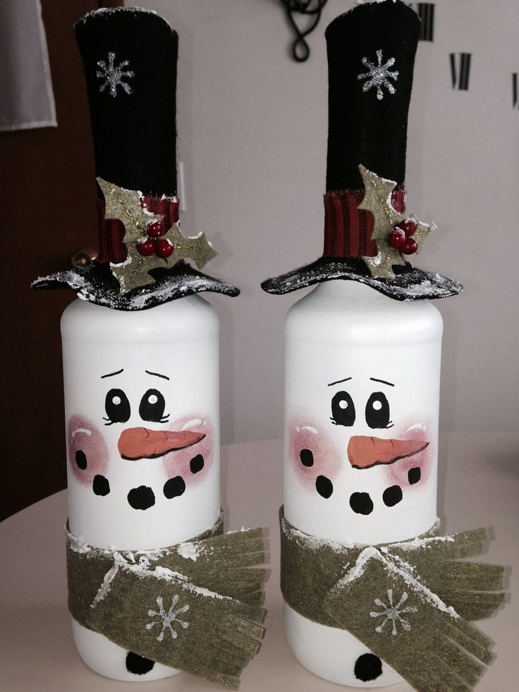 Spray painted wine bottles with painted faces and felt accessories! (Hat comes…
