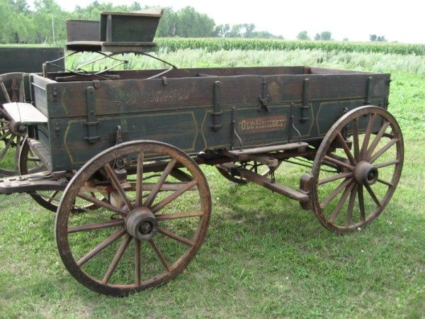 This horse carriage for sale looks good to carry hay bales and barrels of liqueur to take home.