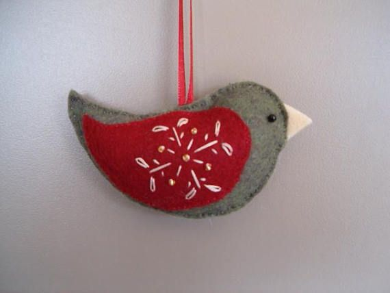 This beautiful Bird ornament can hang off your Christmas Tree, doorknob, in a nursery or anywhere/anytime in your home. Perfect for an end of year Christmas gift for a teacher or can be threaded through ribbon on a present instead of a bow! It is hand-stitched and embroidered with a flower