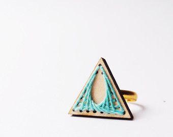 wooden laser cut geometric ring . spirograph . pastel mint green thread . geometric triangle . golden ring