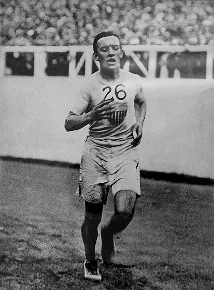 Johnny Hayes, 1908 Olympic Marathon, London.  Hayes finishes 2nd to Dorando Pietri of Italy, but is declared the winner when Pietri collapses near the finish line and is illegally assisted.