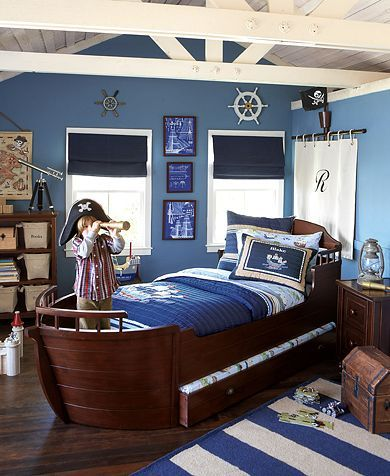 Jack's pirate room: I love the detailing on the wall with the boat steering wheel, curtain, etc.