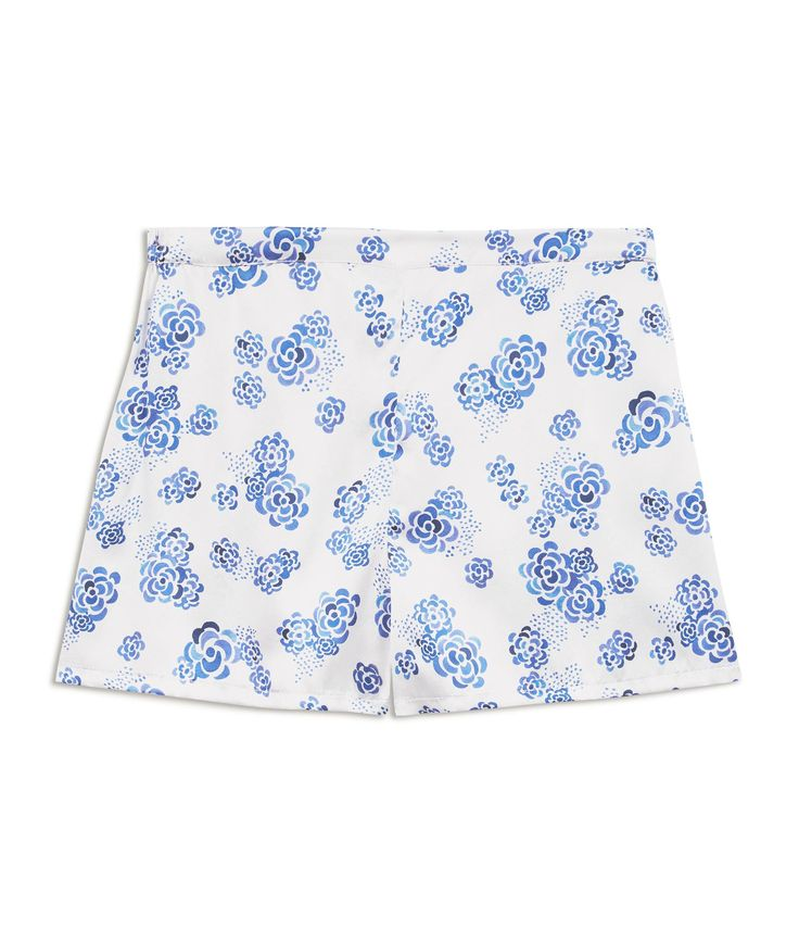 Ditsy Lotus Silk Shorts £154 - One of our favourites, these perfect White, Blue Floral Silk Pyjama Shorts – with just a hint of retro inspiration – are short enough to be sexy but long enough that you won't mind opening the front door. They sit just below the waist but are not low cut and the smooth, flat fronted waistband and softly elasticated back mean they fit like a dream. Choose for yourself how you style our unique capsule pyjama collection.