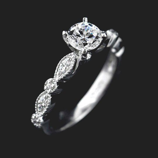 """The Amore, meaning """"love"""" in Italian, is a beautiful and delicate Vintage Engagement Ring. This engagement ring is accented with channel bead set natural recycled diamonds in a delicate milgrained band.