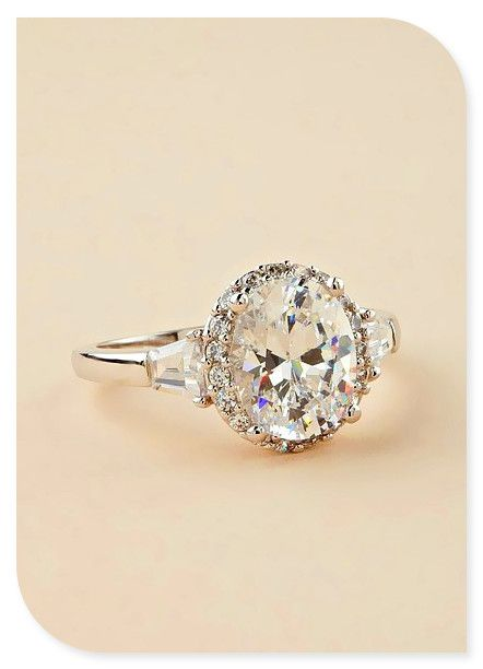 This is gorgeous. It has a very simple setting and lets the centered diamond do the talking.