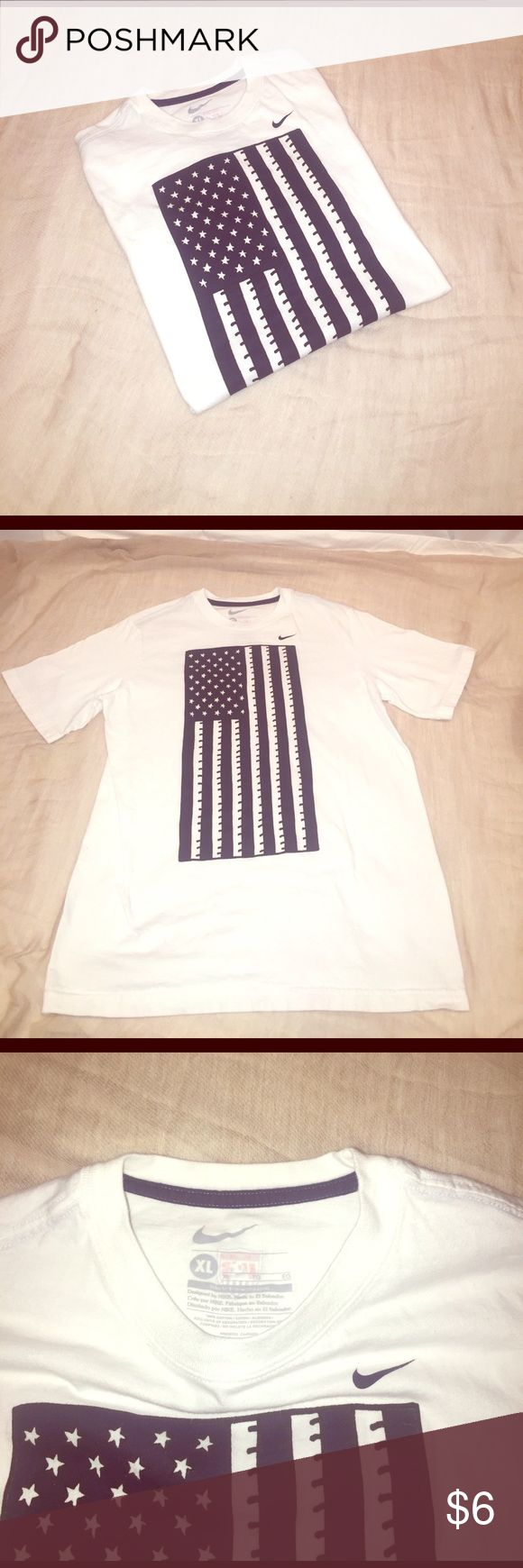 Nike Boy's USA White T-Shirt Nike Boy's USA White T-Shirt with American flag vertical on the front. Back has a small USA soccer logo. 100% cotton. EUC Nike Shirts & Tops Tees - Short Sleeve