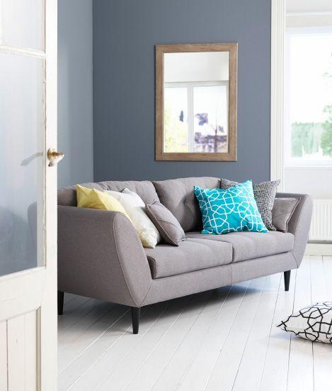 Kodin1, olohuone, Soundi-sohva, Anno-tyynynpäälliset: Aarre, Paperiruutu, Lumikello.