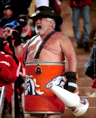 The first Denver Bronco to be inducted into the Pro Football Hall of Fame wasn't John Elway -- it was Super Fan Tim McKernan, AKA The Barrel Man, in 1999. Yes, McKernan was the first Hall of Fame Bronco. Make no mistake, the Barrel Man was synonymous with Denver Broncos football, perhaps more than any fan and team, ever.