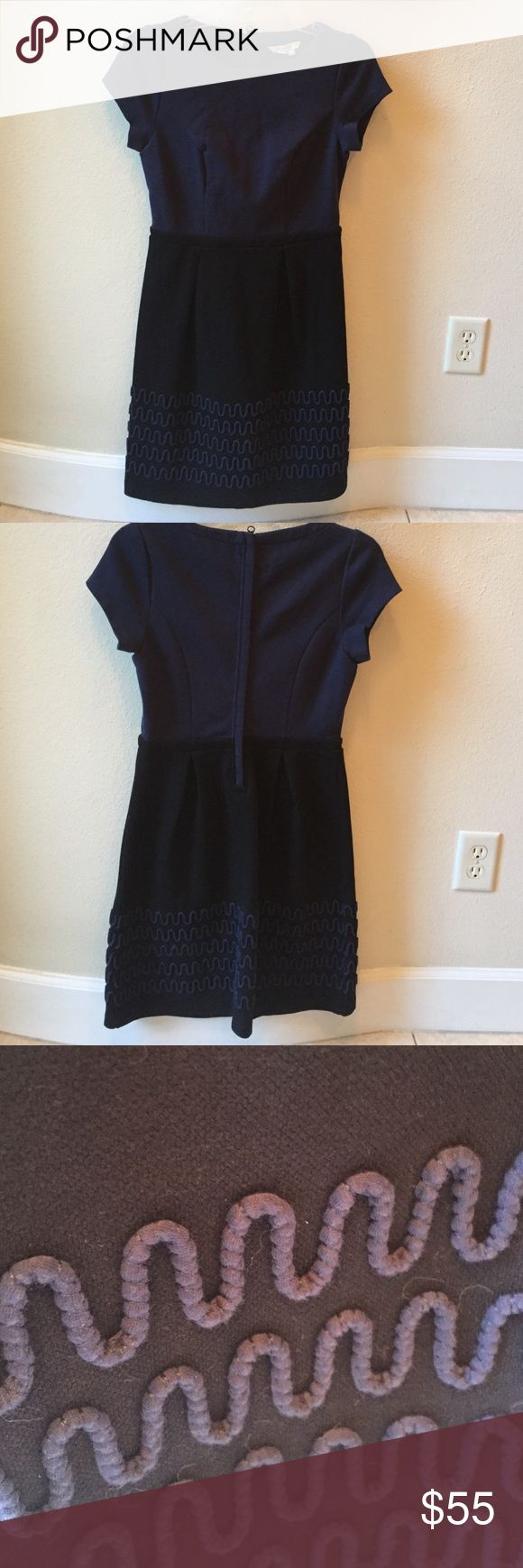 Boden Navy and Black Dress This is a great going out dress, but could easily be worn to the office. Thicker cotton blend. Top part is navy and bottom is black with the navy embroidery. Back zip. Comfy but chic. Looks great with boots. Wore once! Boden Dresses Midi