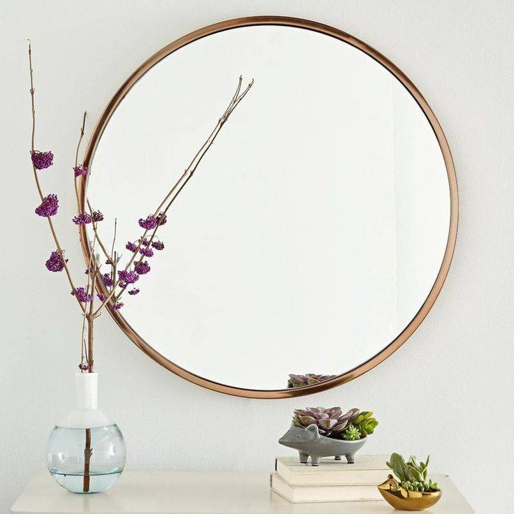 Our best-selling Metal Framed Round Mirror gets an update with a fashionable rose gold finish. Softly rounded edges make it an easy fit with furniture of any shape or style.