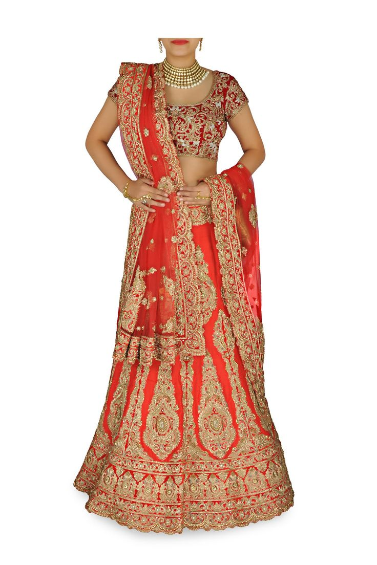Featuring a Tomato red silk lehenga with zari embroidered applique designs all over; scalloped design at the hem. Matching red embroidered blouse and net dupatt