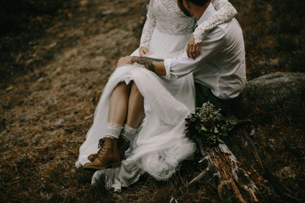 Stylish bride in boots | Snowy Mountain Elopement in Estes Park