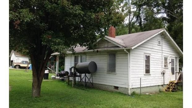 """INVESTORS SPECIAL"""" 2 Bedroom, 1 bath rental house in convenient location on N.Main Street. Hardwood floor coverings. Currently rented with good rental history. Priced right and BELOW tax value and selling AS IS. Additional adjacent properties for sale Pin# 8657-92-9733 and #8657-92-9608 *** Interior photos to come, pending schedule with tenants ***"""