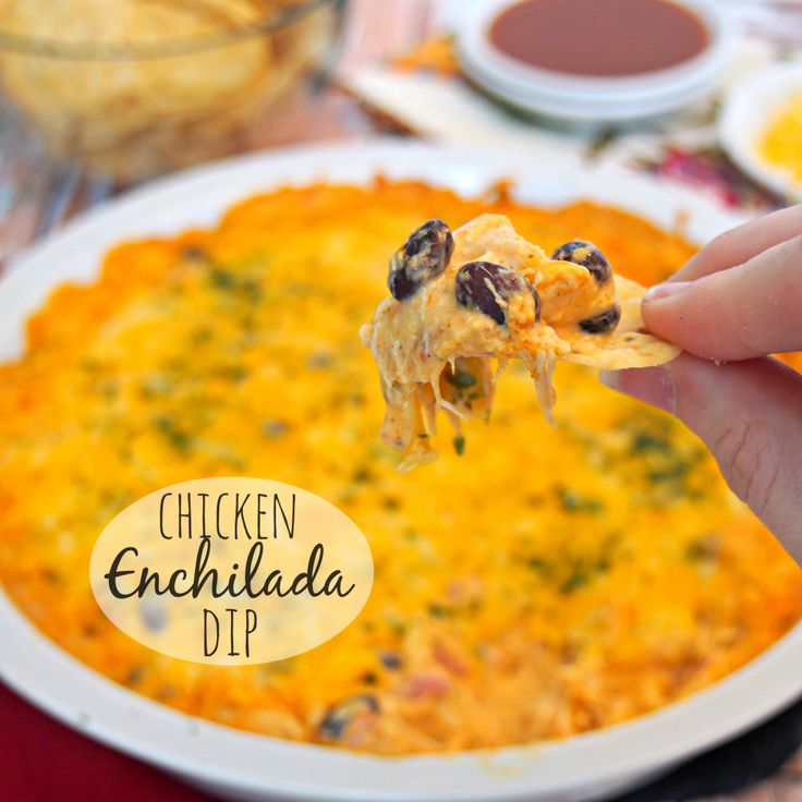 Cheesy Chicken Enchilada Dip is the best dip ever! My family goes crazy for this easy, cheesy, delicious dip. So good and simple.
