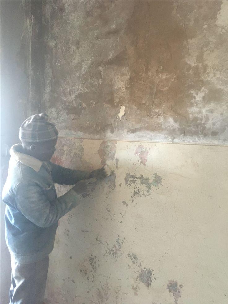 Sanding the walls in guest room 1