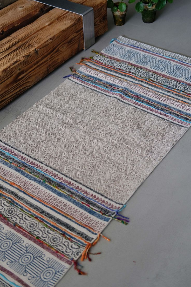 Beautiful blockprinted rug with colorful fringes for a unique look.