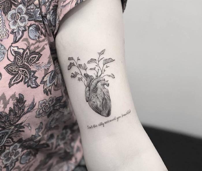 Anatomical Heart Tattoo on Bicep by Nando Tattoo