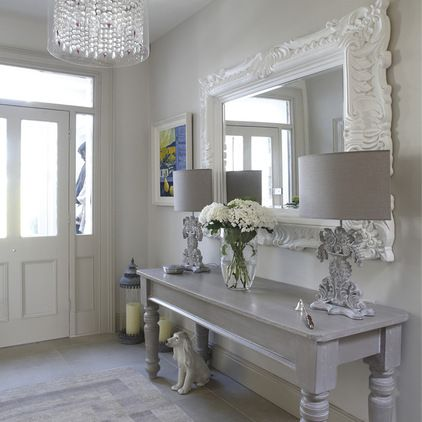 grey painted furniture, ornate mirror and lamps.  Lamps could be a flea market find. eclectic hall by Optimise Design