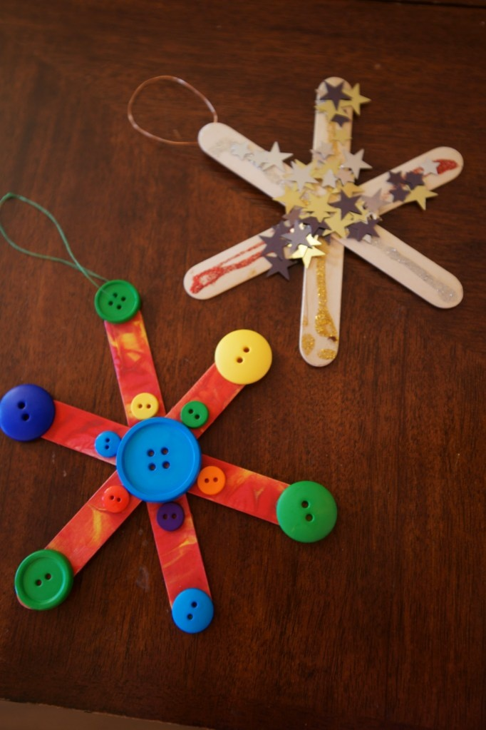 Homemade popsicle snowflake ornaments - kid friendly Christmas craft @Gwen Freeman ~ would these be good donatable items for the cubs to work on??