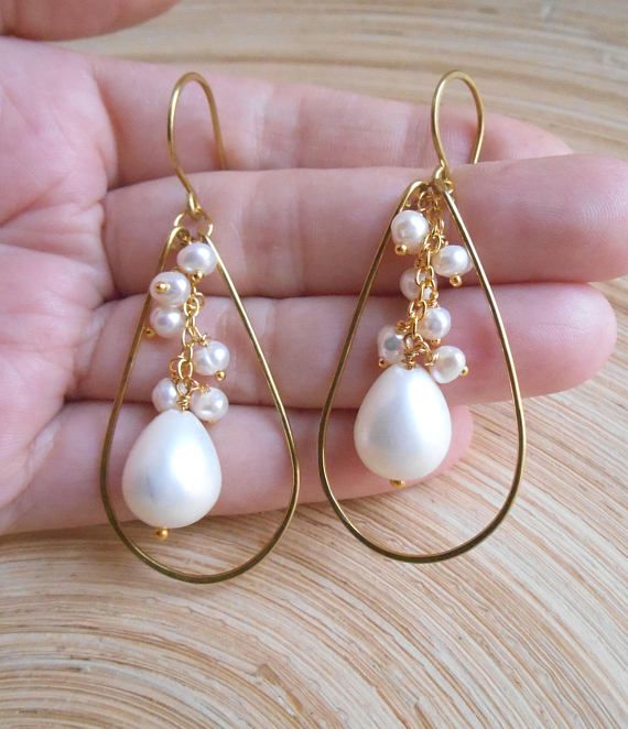 Youll adore this elegant pearl cascade of Jasmine bridal earrings, where lustrous freshwater pearls glow against the gold filled wire frame. I hand formed and lightly hammered a teardrop shaped frame out of gold filled wire. In the center of it hangs from a 14K gold vermeil a lovely