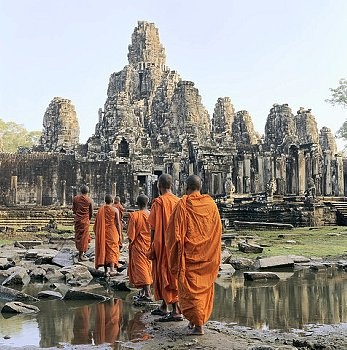 Buddhist monks outside temple at Angkor Wat …